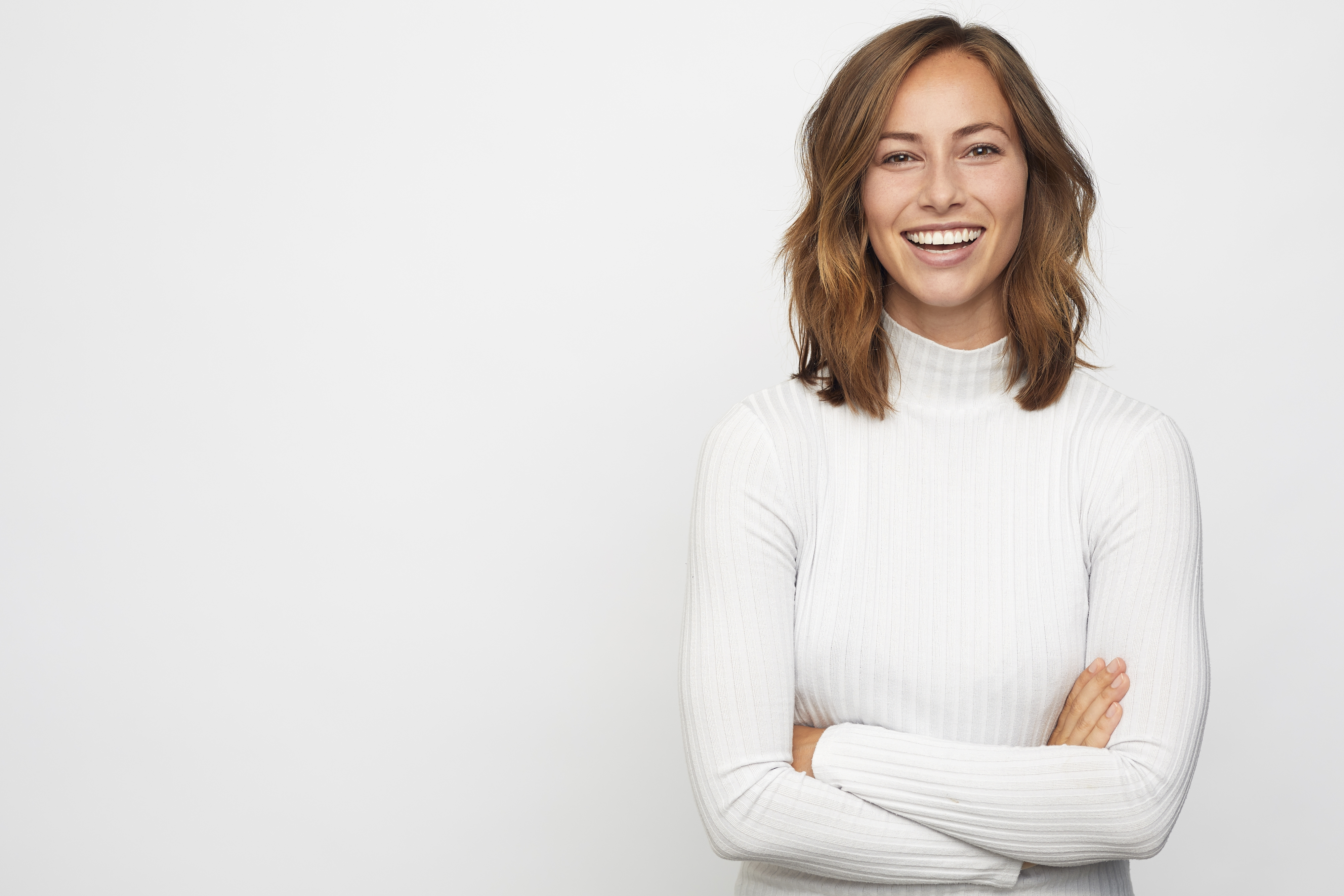 Smiling woman in a white sweater