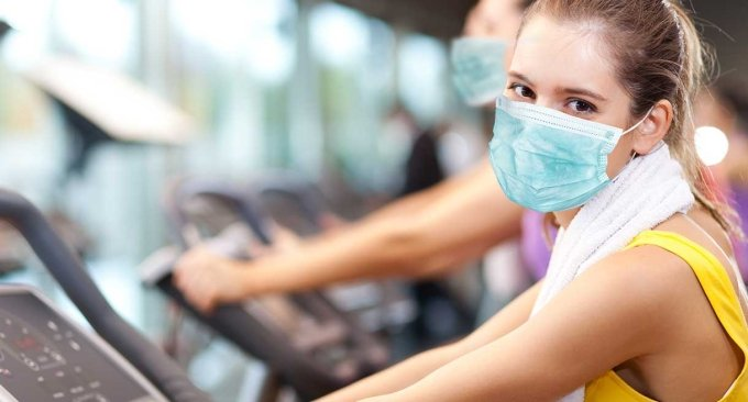 woman exercising with a mask on